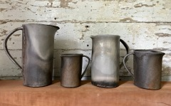 "Kat Habib, Pitchers. Wood-fired stoneware. Size range from 4.5"" x 5"" x 3.25"" to 9"" x 8"" x 4.5"""