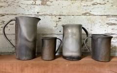 "Kat Habib, Pitchers. Wood-fired stoneware. Size range from 4.5"" x 5"" x 3.25"" to 9"" x 8"" x 4.5"""